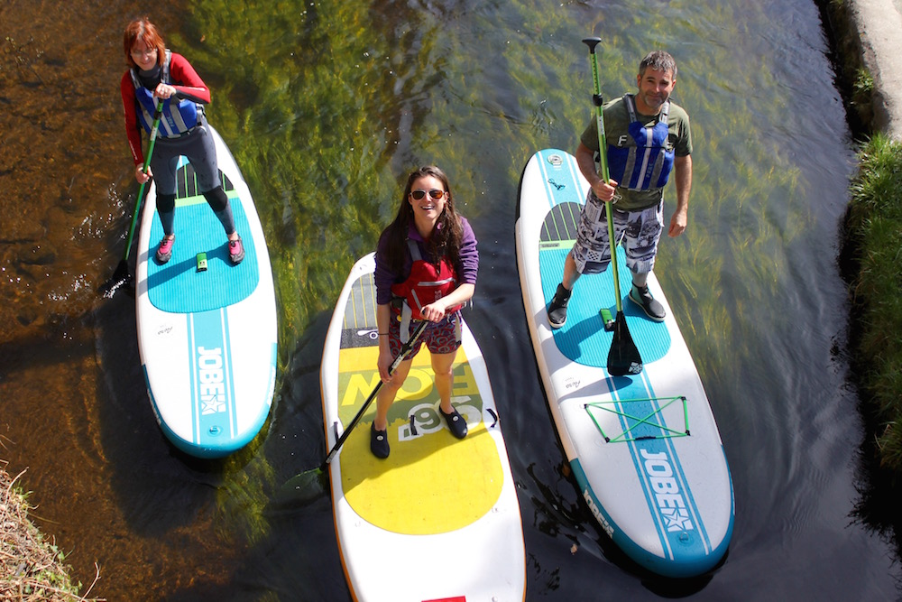 Stand up paddle boarding group
